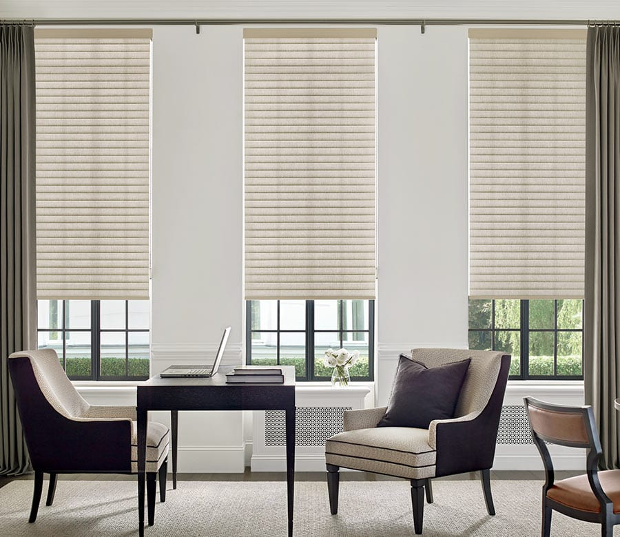 three window with shades and drapery layered in home office in Baybrook TX