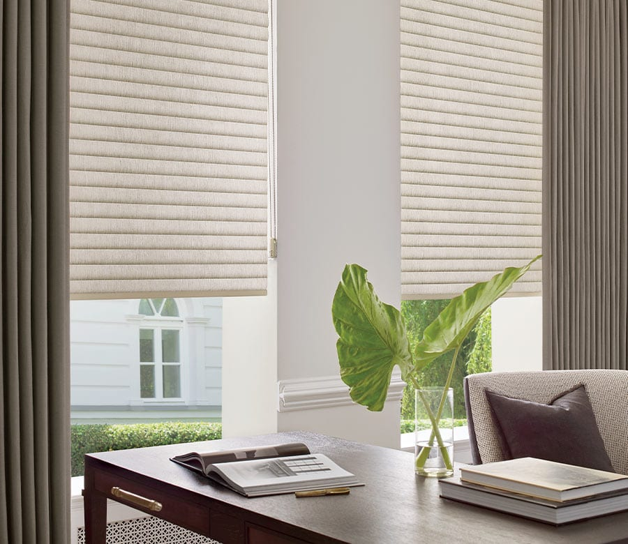 home office with cellular roller shades and layered drapery in Magnolia TX