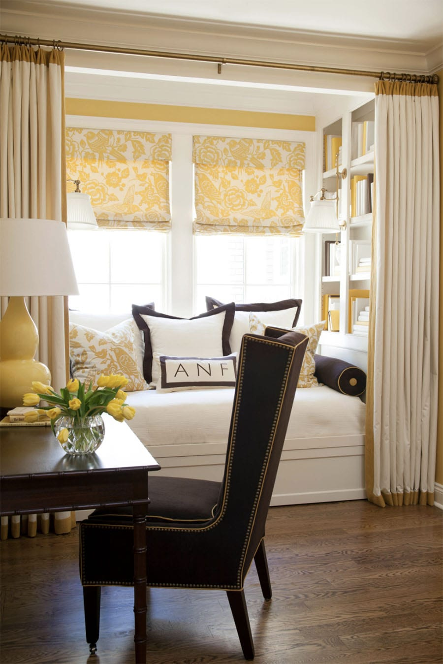 dining room bay window nook with yellow roman shades