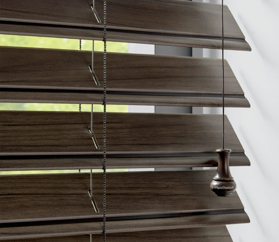 close up of dark faux wood blinds in houston area home