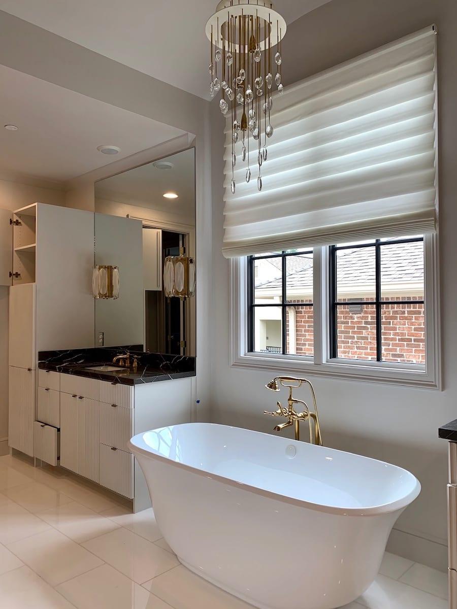 white bathroom with fabric roman shades in Houston TX