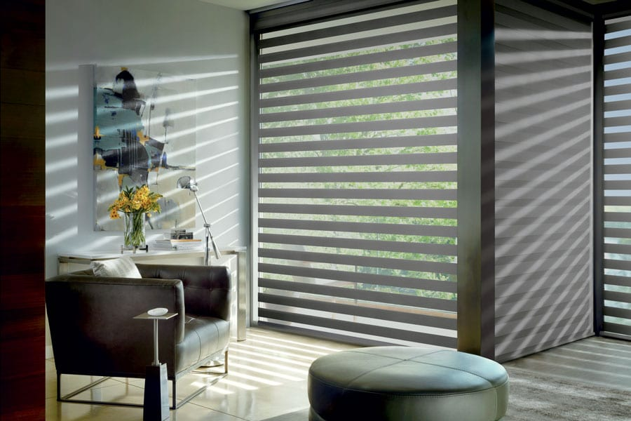 Banded roller shades on floor to ceiling windows in Houston TX