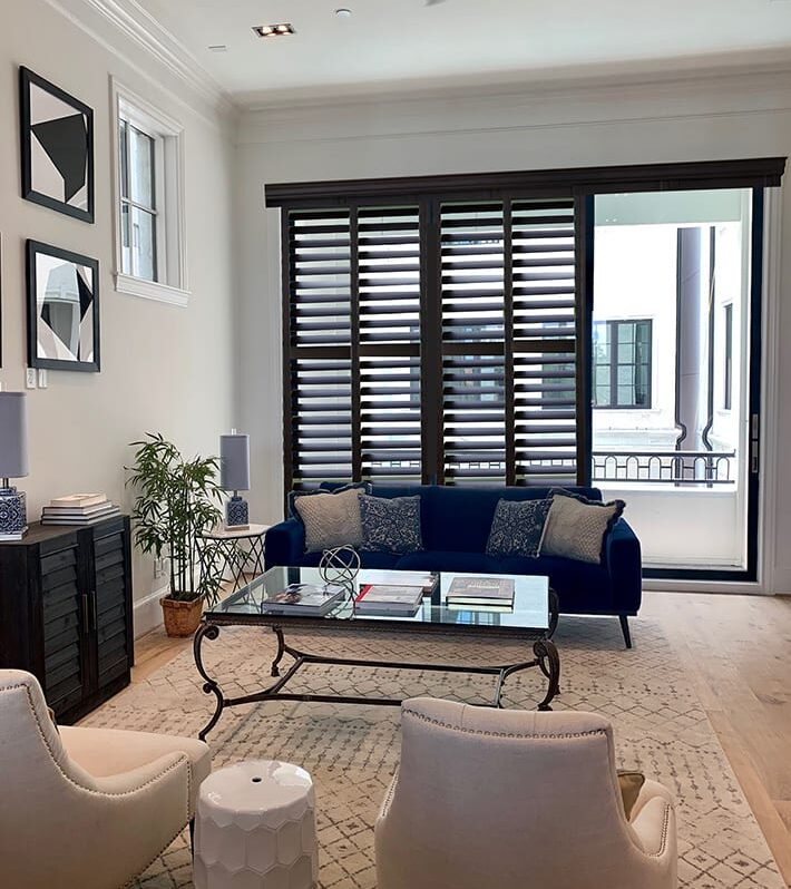 dark wood shutters as window treatments for doors on sliding glass doors in Houston TX living room