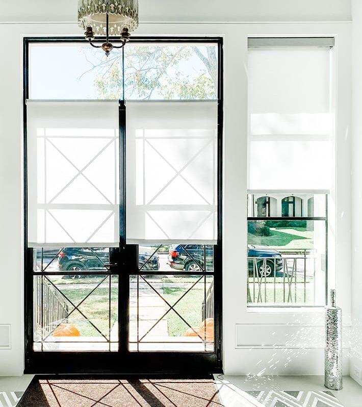 white roller shades on black framed french doors in Memorial TX