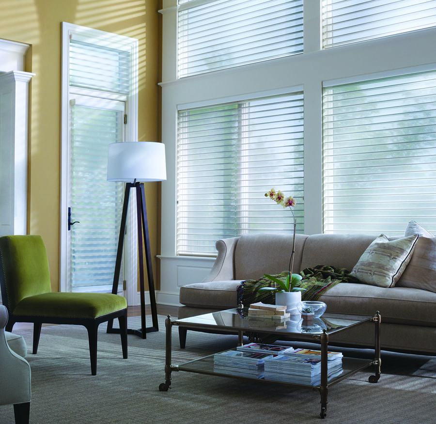 tall windows covered with white sheer shades in Houston TX