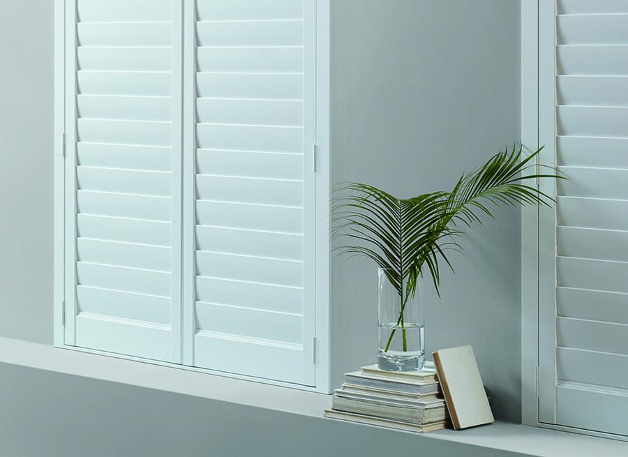 living room newstyle hybrid white shutters bedroom darkening solution
