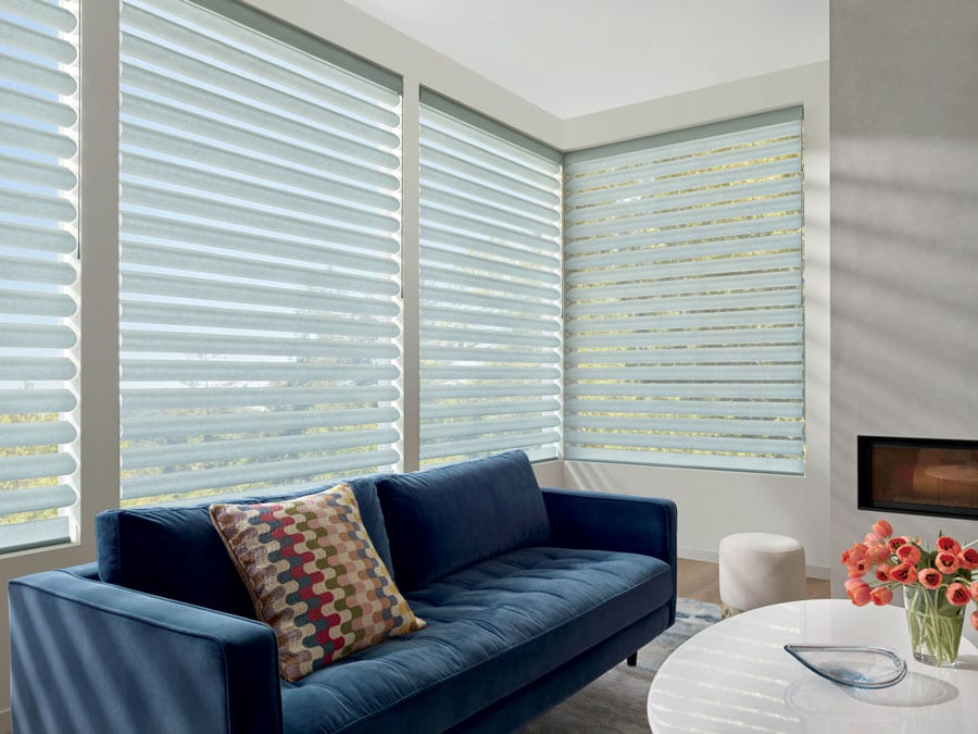 tricky windows with window shades in the corner of the room in Houston TX home