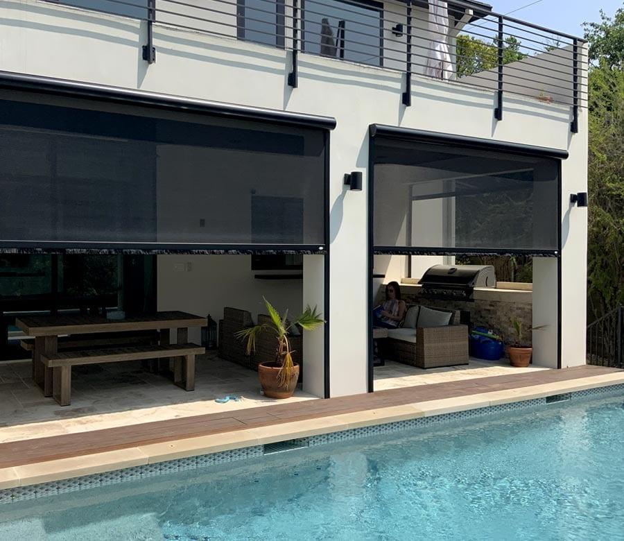 black exterior patio shades on Houston TX home next to the pool