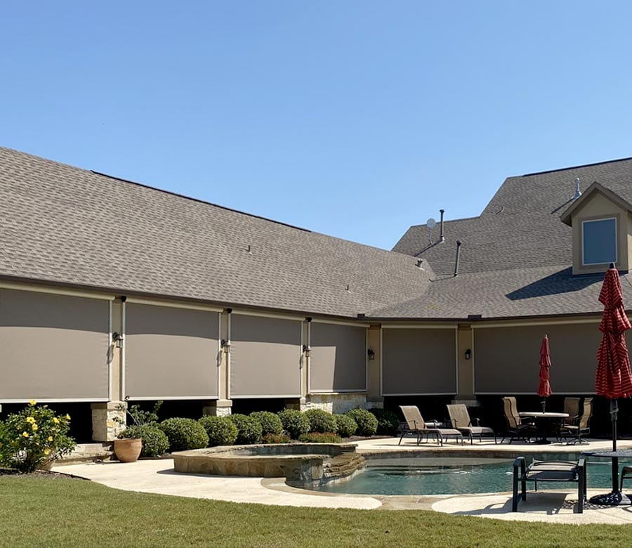 opaque patio shades to block light on multi-section patio in the Woodlands in Houston TX