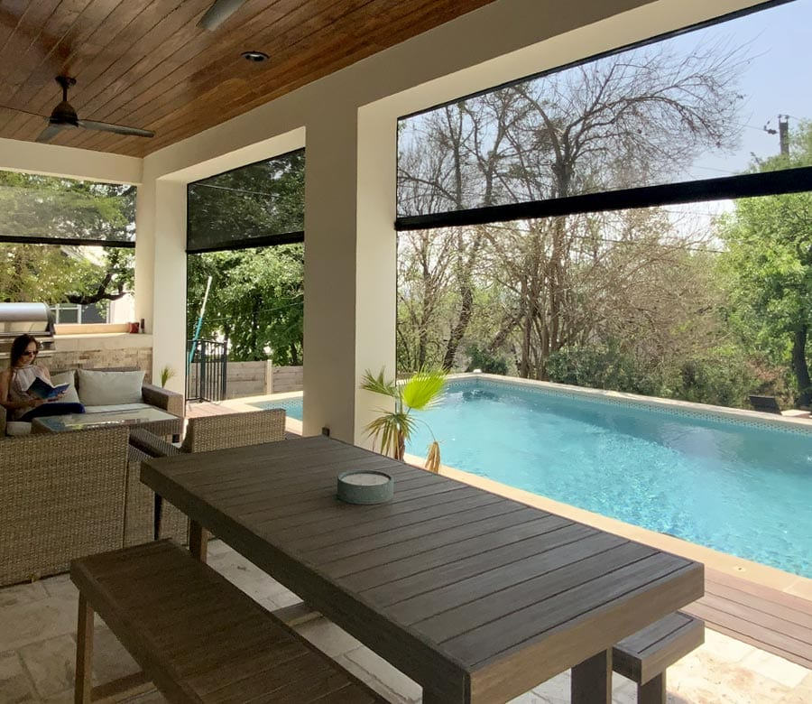 poolside patio with black exterior screen shades to bring the outdoors in for Houston TX home