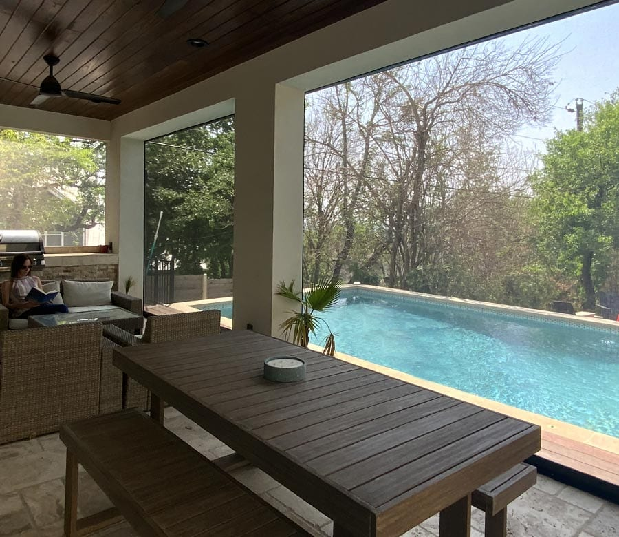 poolside patio with exterior shades at Houston TX home
