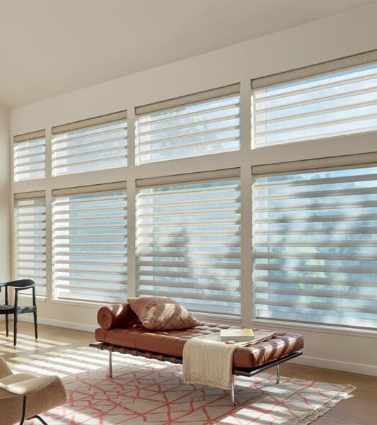 tall windows covered with floor to ceiling blinds from Hunter Douglas pirouette shades window treatments for large windows in Magnolia TX