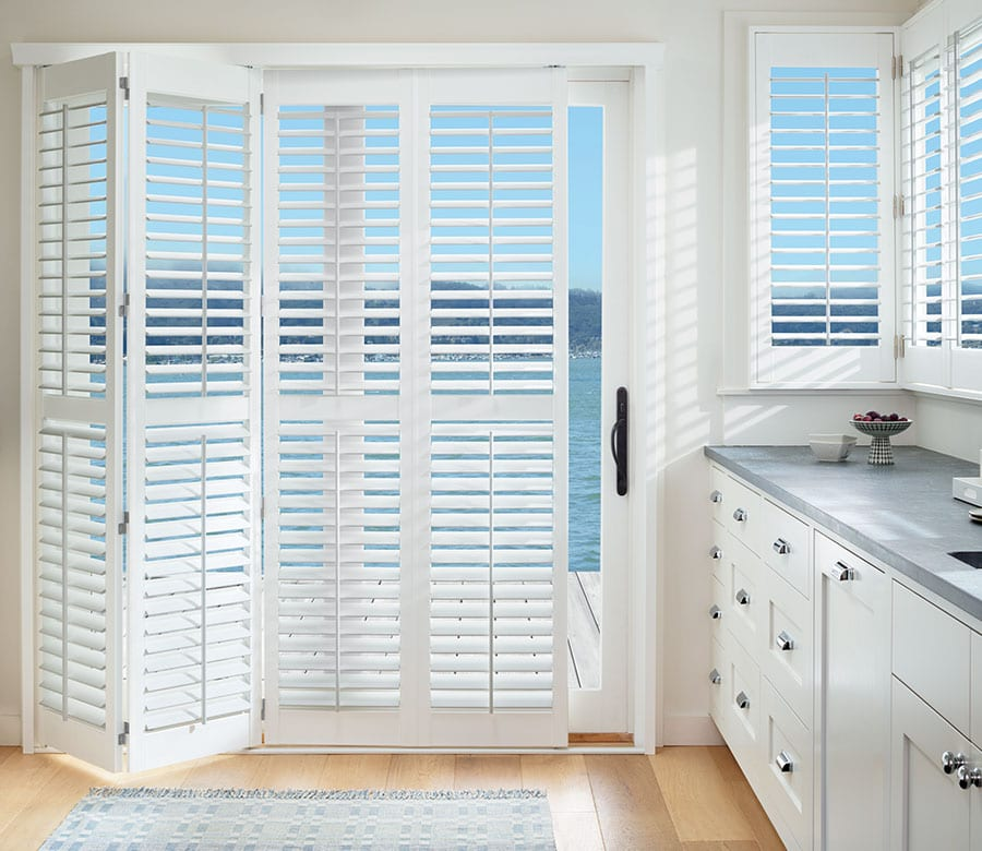 sliding door with accordion shutters with lake view in houston texas home