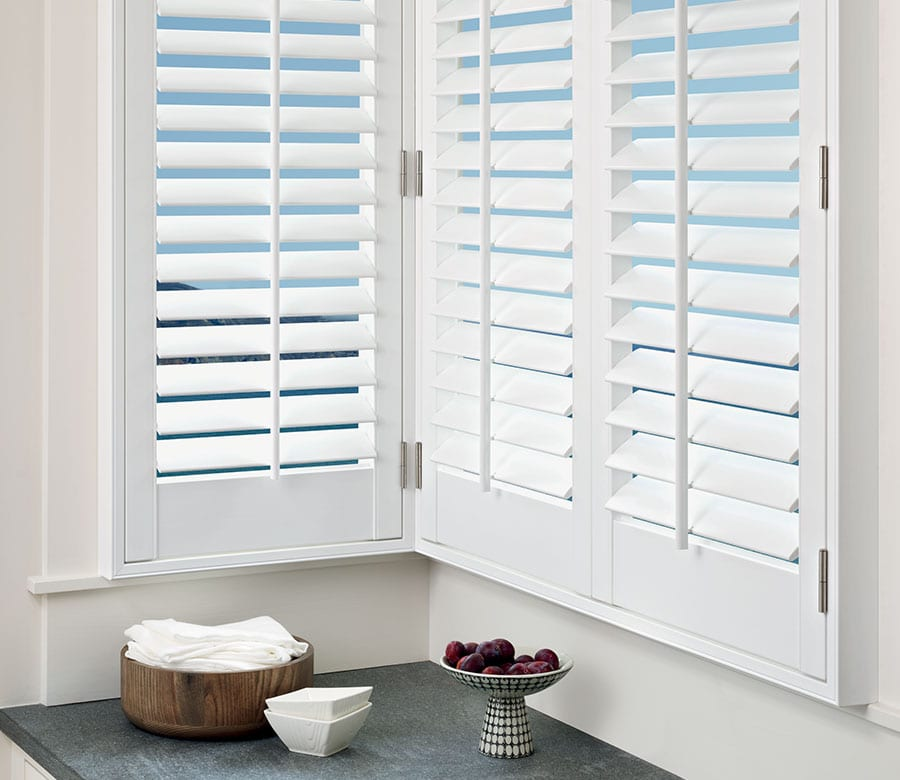 white shutters corner view in Houston tx home