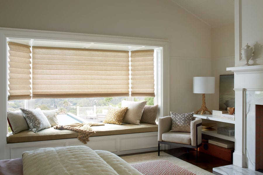 bedroom bay window with gold fabric roman shades in Magnolia TX
