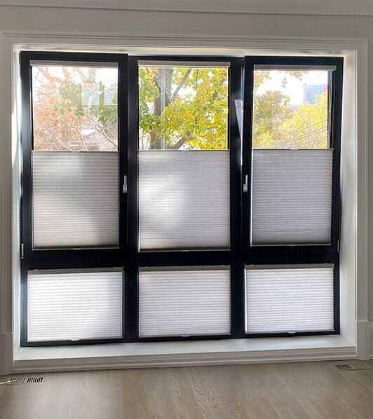 tilt turn windows with honeycomb shades in Friendswood TX