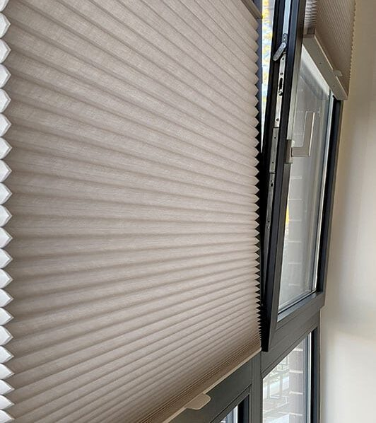 gray honeycomb shades on tilt turn windows with trackglide in Baybrook TX