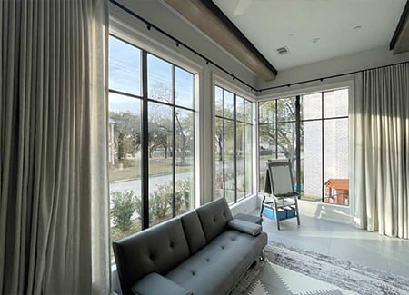 sunroom with floor to ceilings covered with drapery