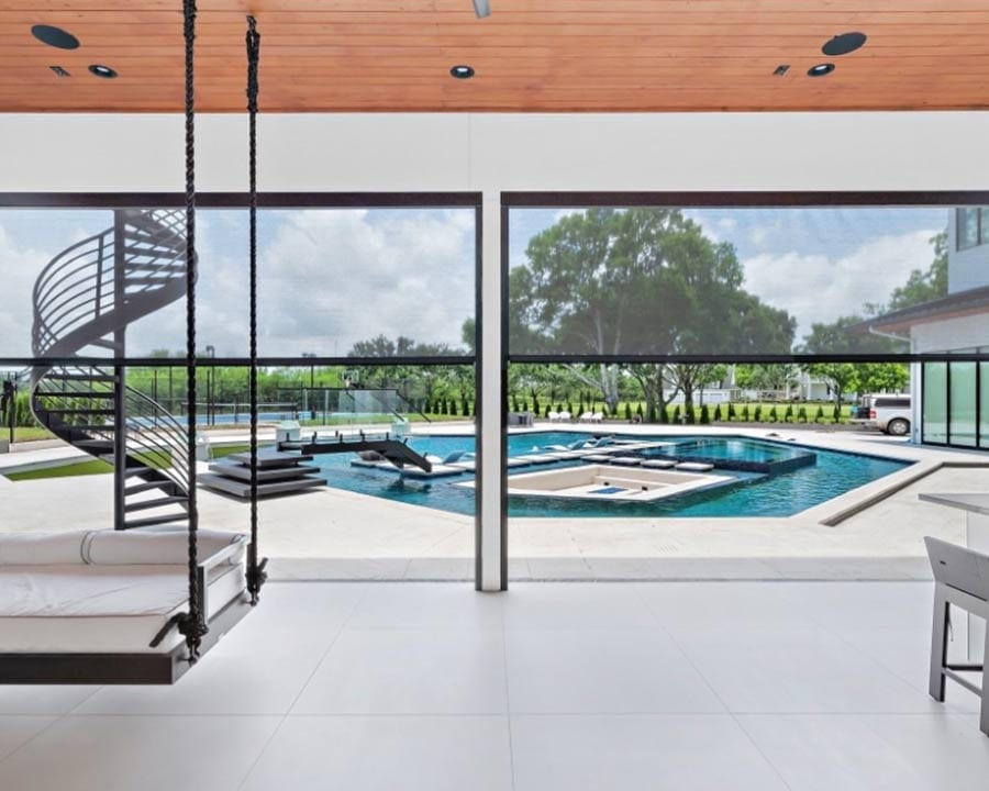 sunroom with large windows overlooking a pool for an outdoor oasis in Houston TX