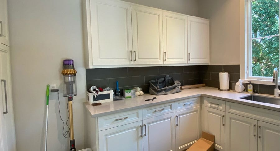 white kitchen before adding wall coverings in Friendswood, TX