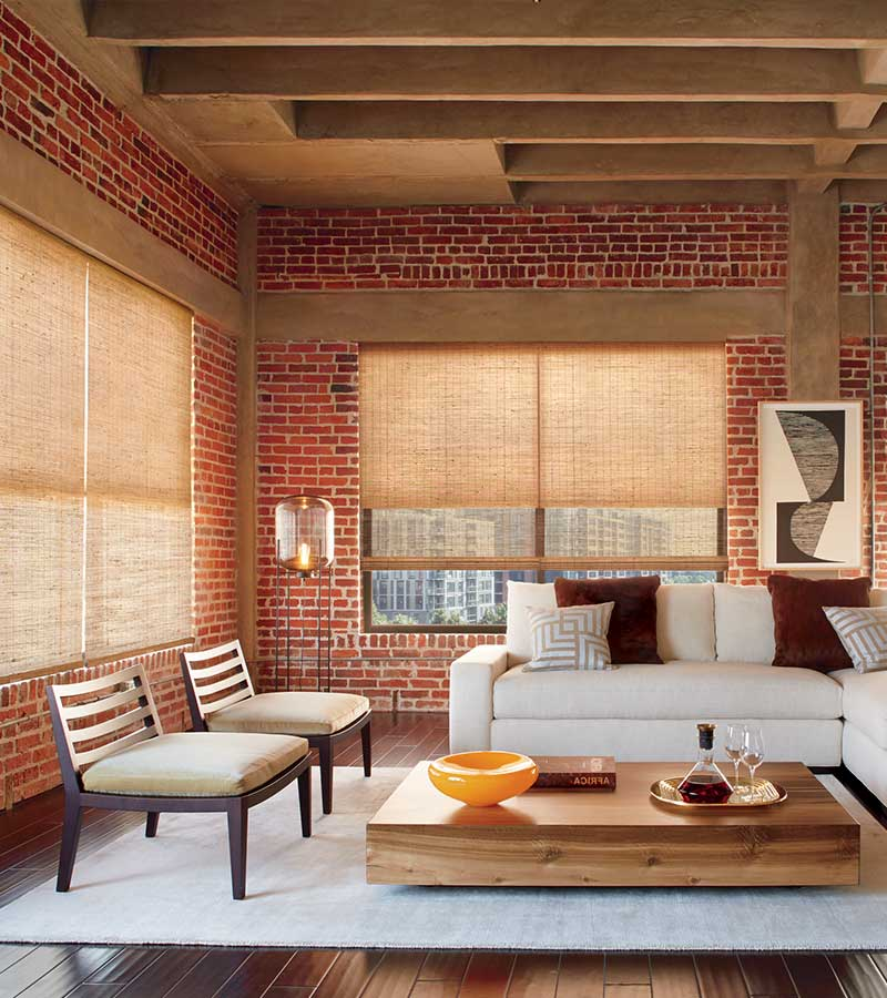 exposed brick loft with woven wooden window shades in houston tx