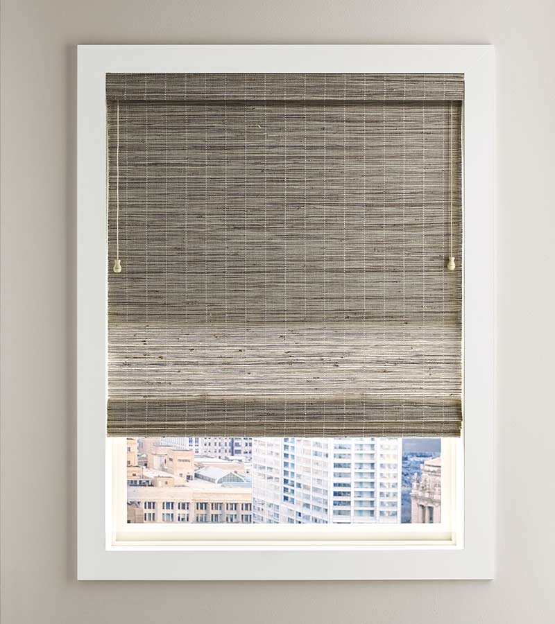 white framed window overlooking city with fabric shade in Friendswood, TX 77546