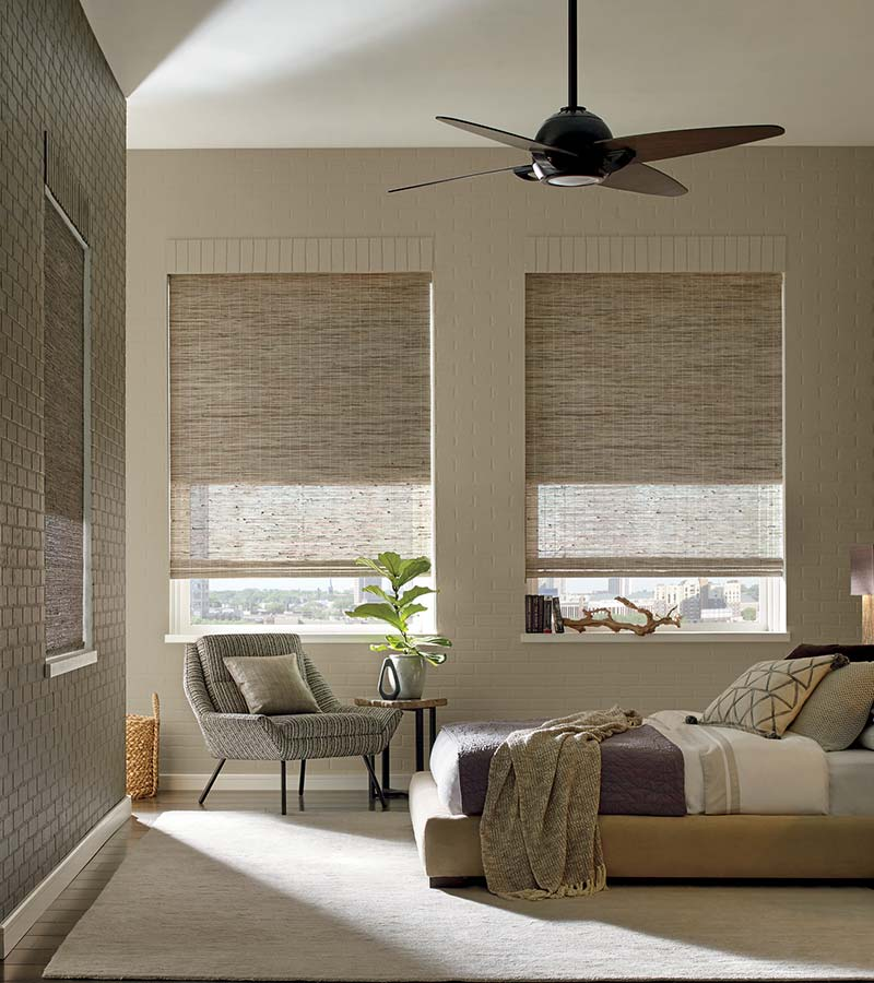 beige bedroom with woven wood shades in Friendswood, 77546