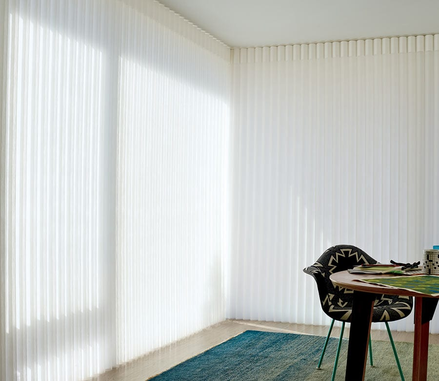 closed floor to ceiling vertical blinds in Houston TX home office