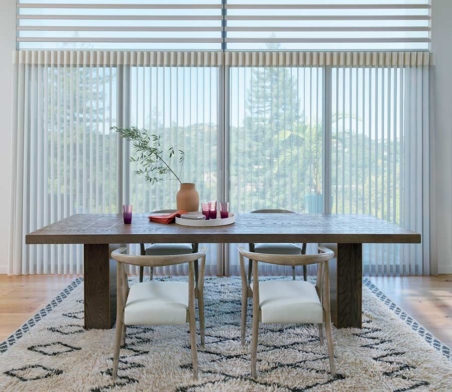 Modern dining room with floor to ceiling privacy sheers in the Woodlands, TX