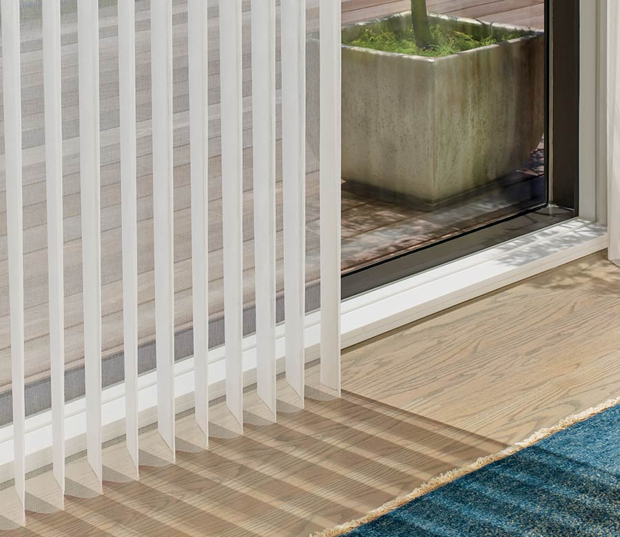 detail of vertical white privacy sheer fabric folds