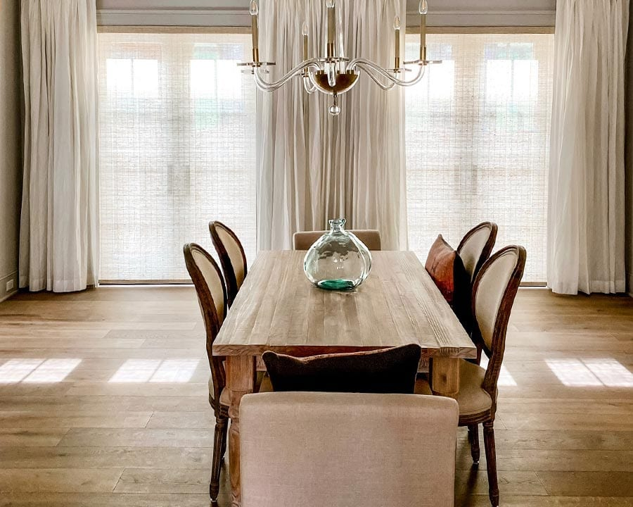 provenance woven wood shades in large dining room with wood floors