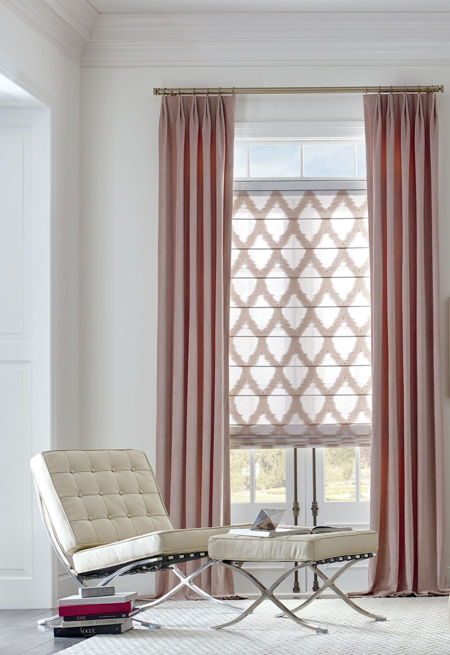 rose colored drapes with patterned fabric roman shades in Baybrook TX