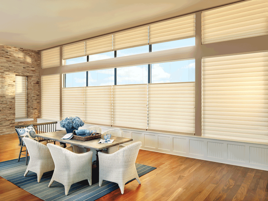 dining room in Houston home with tall windows covered with modern roman shades
