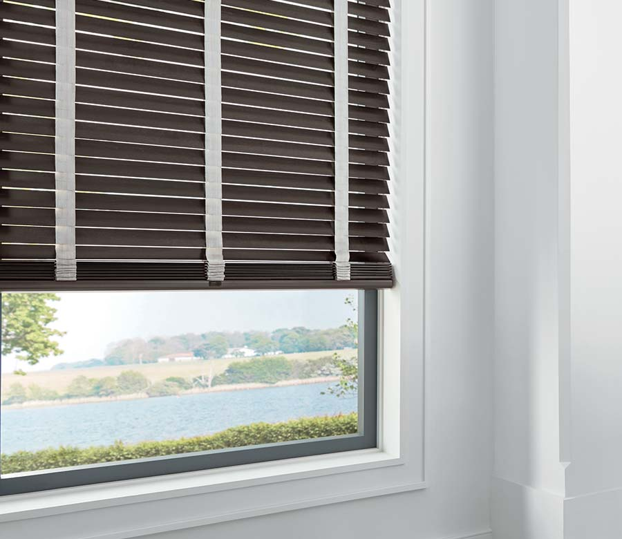 brown wood blinds in white room