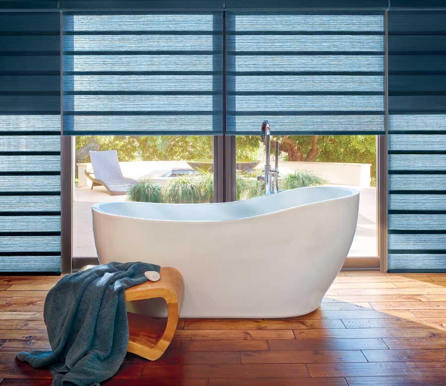 blue jewel toned roman shades in modern bathroom