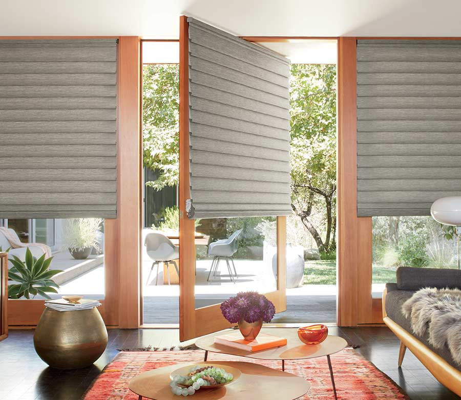 gray shades in boho sunroom next to glass patio doors