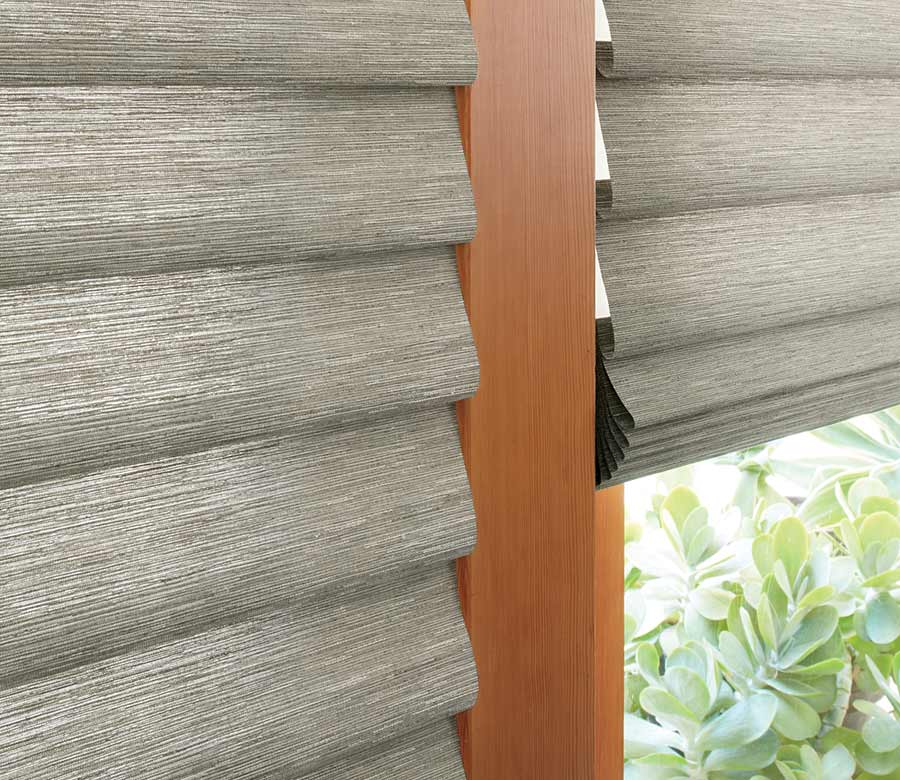 detail of gray green fabric shades on patio door