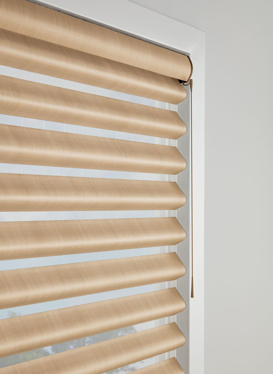satin gold window treatments with motorized control in Memorial TX home