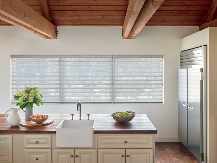 kitchen with motorized sheer shades on windows in Baybrook TX